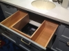 A bath cabinet where a custom cutout is made under the sink to allow for a drawer cabinet instead of the typical sink base.