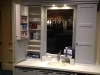 A bath cabinet where a kitchen pantry door insert allows for extra accessible storage in the bath vanity.