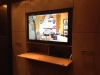 This drop down cabinet is a great idea for TV accessories.