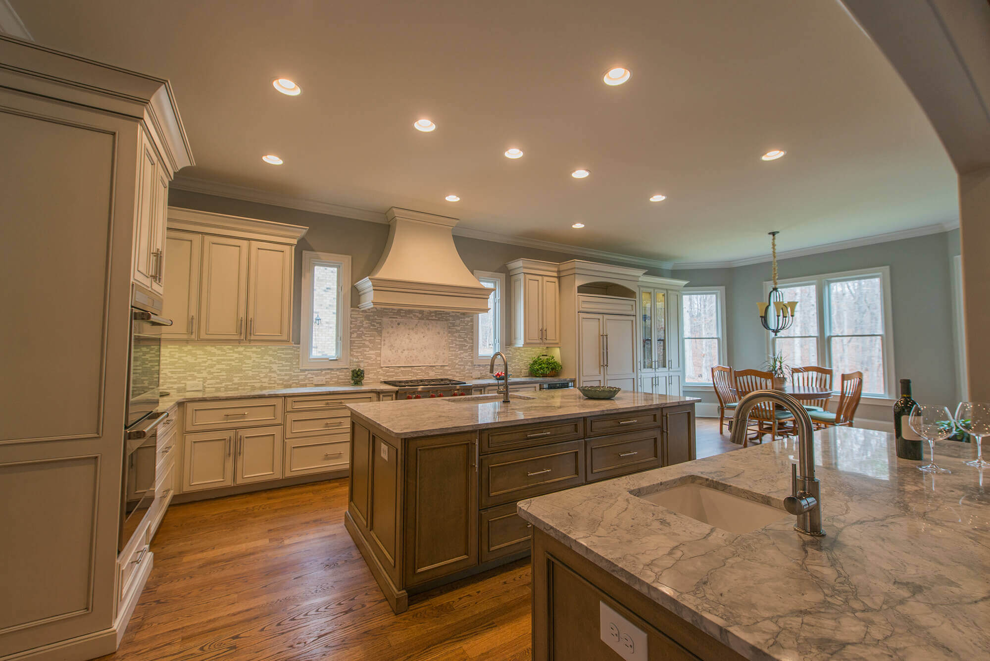 Transitional Kitchen With 2 Islands